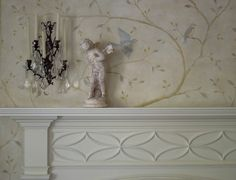 A Swedish inspired hand painted mural around the dining room mantel.