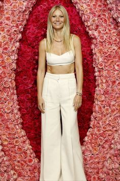 Double entendre: Gwyneth Paltrow went all out with the female anatomy–inspired decorations when she posed in front of a vulva-shaped flower arrangement Tuesday at a special LA screening of her new Netflix docuseries The Goop Lab Gwyneth Paltrow, White Bandeau, Bandeau Top, Mirror Jacket, Glamour Magazine Uk, Golden Dress, Models, Celebs, Celebrities