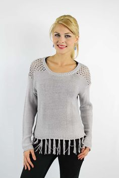Enewwholesale sells Grey knitted sweater with fringed hemline. Wholesale fashion women's tops online store with discount price