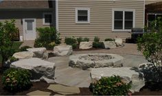 The Site Group in New Carlisle used large boulders as seating that matches the #firepit. We love the effect it creates. #housetrends http://www.sitegrouplandscaping.com/our-work/project/miller-landscaping