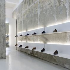 "dezeen: "" More from Bulgaria: White shelves hang from crumbly concrete walls in this shoe shop by Elia Nedkov Shoe Store Design, Shoe Shop, Boutique Interior, Shoe Boutique, Retail Interior, Office Interior Design, Commercial Design, Commercial Interiors, Shop Interiors"