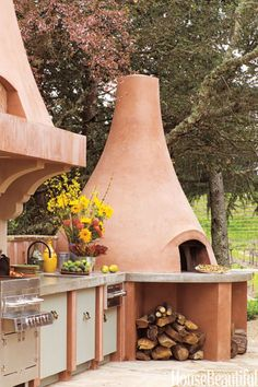 Terracotta Hues: This outdoor kitchen in California takes its colors from the earth and the sky. For more outdoor kitchen design ideas, click through!