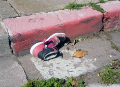 The vibrational frequencies of the abandoned shoe just seemed to resonate with the faded red curb and the decrepit gutter scenery. Beautiful.