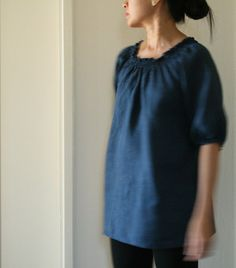 READY TO SHIP    The W blouse is handmade from light weight linen with shirring details along neckline, extended sleeve and back. Loose fitting in front with a more flattering fit behind. Falls to approximately 69cm/27 in length. Layered over jeans, pants, even a skirt! Very comfortable autumn, spring, summer piece. May also be worn as a maternity shirt.    SIZE XS Bust • 84cm / 33  Waist • 64cm / 25  Hip • 92cm / 36    100% linen    Ships within 2 business days with Australia Post via…