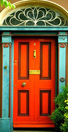 orange and turquoise (Multi-coloured door by Steve-h, via Flickr)