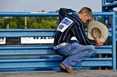 Saddle Bronc rider Nat Stratton, lowers his head for prayer during day three of the International Youth Finals Rodeo at the Shawnee Expo Center in Shawnee, Okla. Tuesday, July 10, 2012.   Photo by Chris Landsberger, The Oklahoman