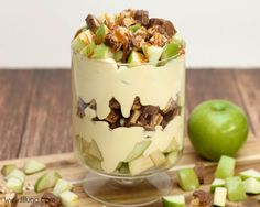 Delicious Apple Snickers Salad that is so good and so easy to make! { lilluna.com } Layers of apples, snickers, and caramel in a creamy topping made from cool whip, milk, and vanilla pudding mix.