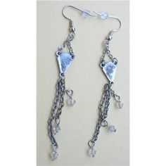 E69. Silver Rosary Charms with Rhinestone Dangles Earrings. $25.00