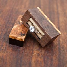 Ring box made from black walnut and olivewood burl. Hidden magnets on the one part of the box. Unique item soon available in store! . . . . . #engagement #ring #box #wedding #proposal #diamond #weddings #marriage #jewelry #rings #fiancé #weddingring #diamondring #engagementring #woodworking #wood #handmade #walnut #handcrafted #etsy #craft #woodporn #carpenter #hardwood #design #olivewood #burl #etsyfinds #thenorthernforest