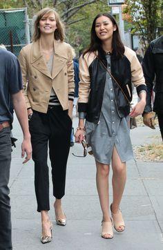 Karlie Kloss and Liu Wen work two jacket trends: classic trench and trendy bomber.