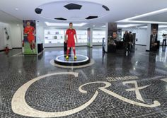 New Museum dedicated to Cristiano Ronaldo opens in Funchal, Madeira, Portugal - Inaugurated on December 2013 Spacious: Both waxworks have Ronaldo pitted in a Portugal kit, rather than current club Real Madrid Portugal, The Two Ronnies, Cristiano Ronaldo Cr7, Funchal, Beautiful Places To Visit, Real Madrid, Night Club, Places Ive Been, Soccer