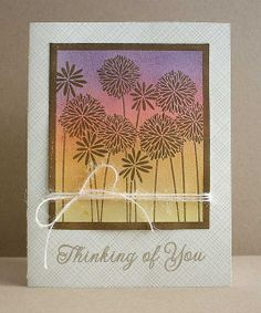 """By Sarah M. (sarahjane4kids on flickr). Uses Hero Arts negative stamp """"Flower Medley."""" Ink stamp with yellow, orange, pink, & purple in an ombre pattern. Stamp on brown cardstock. Heat emboss with clear powder. Add white twine. Stamp white card front with Hero Arts """"Envelope Pattern."""" Pop up image panel onto card. Add sentiment."""