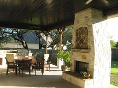 Covered patio with Texas limestone fireplace