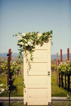 Rustic outdoor wedding decor inspiration - how about using a vintage door decorated with flowers as your aisle backdrop. Wedding Ceremony Ideas, Ceremony Backdrop, Ceremony Decorations, Wedding Backdrops, Reception, Backdrop Ideas, Outdoor Ceremony, Flowers Decoration, Outdoor Venues