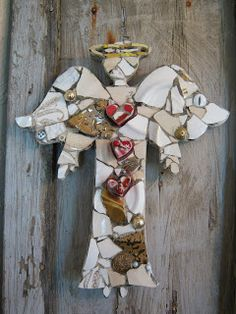 """Mosaic angel with three heart mosaic """"buttons""""."""