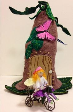 Felted Fairy Home - A step by step tutorial and free pattern show you how to create a Felted Fairy Home from a felted sweater, felt, embroidery thread, lace, and a cornmeal container. This project can be completed in a weekend depending on how many embroidered leaves are added to the house. This felt craft is perfect for anyone who wants to learn how to make a toy for their children or grandchildren. Homemade toys are the best! Kids will love this fun, magical take on the traditional doll ho...