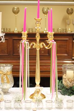 Gold candelabra ribboned with pinks and greens Gold Candelabra, Gold Wedding Theme, April 7, Pink And Green, Ribbon, Candles, Tape, Band, Ribbon Hair Bows