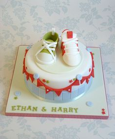 https://flic.kr/p/azUw6D | Christening cake | The customer asked me to make a Christening cake for her two boys. To represent the boys, she wanted a baby shoe and a football boot.