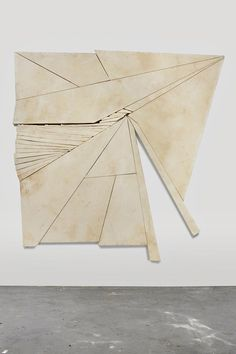 "Wyatt Kahn - Contender (2012) - Unpainted canvases stretched onto irregularly shaped frames Artist's statement:  ""I am trying to push sculpture to the limits of painting."""