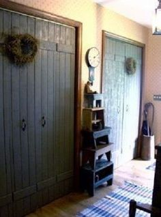 rustic and aged closet doors in hallway..