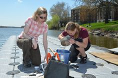 Carrie Kissman helping a student with research on the Fox River.