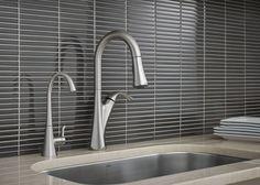 A pulldown faucet and bold backsplash make the perfect kitchen pairing.