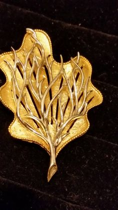 Check out this item in my Etsy shop https://www.etsy.com/listing/211746259/vintage-signed-coro-leaf-silver-and-gold