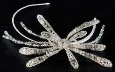908A. Silver decorated sideways design with Swarovski crystals. Silver shade crystals and black diamonte.