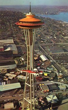 1962 Seattle World's Fair postcard. For my 65th birthday, I took some of my kids and grandkids to the top of the needle for dinner. It was the 50th anniversary of the World's Fair and the needle had been painted  back to it's original orange color to commemorate the occasion.