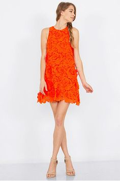 The Orange You Glad Dress features a orange A line dress with 3D floral applique. Exposed zipper closure on back. - Color: Orange - Material: Polyester - Runs True to Size