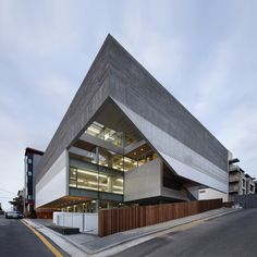The stacked volumes that make up this multipurpose building in Seoul's Gangnam district are clad in various materials and diminish in size like the components of a nested Russian doll.