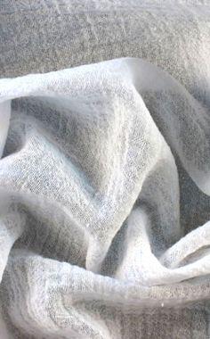 Beautiful, white, all-cotton fabric, like a crinkle gauze. Like Aden & Annais swaddle blanket fabric