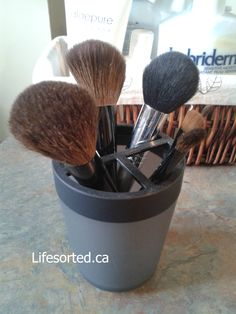 Use a toothbrush holder for your make up brushes