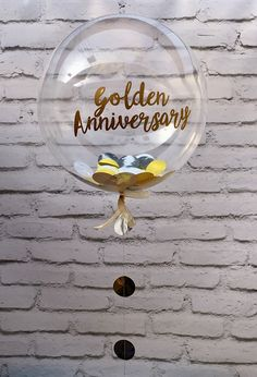 Gold and silver metallic confetti balloon by The Feather Balloon Company. Have it personalised for a Golden Wedding Anniversary or special date. Order from our website...