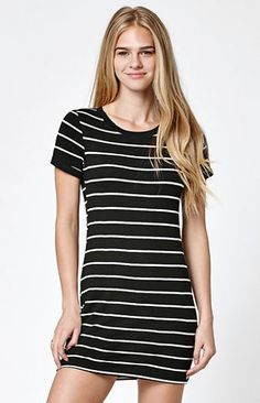 "Online Only! Cute, casual style is a breeze in the Stripe Short Sleeve T-Shirt Dress by LA Hearts. Made from a soft, stretchy fabric, this t-shirt dress has cuffed short sleeves, a crew neckline, black-and-white stripes and a relaxed fit.   	31'' in length 	Unlined 	Cuffed short sleeves 	Crew neckline 	Striped pattern 	Relaxed fit 	Model is wearing a small 	Model's measurements: Height: 5'8.5"" Bust: 34"" Waist: 24"" Hips: 34"" 	73% polyester, 23% rayon, 4% spandex 	Hand wash 	Made in USA"
