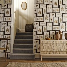 Fern Gallery Wallpaper A beautiful wallpaper with beautifully drawn fern prints placed within frames to create artfully displayed pictures on a wall. Shown in charcoal and spice.