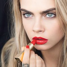"""""""A colour so bold you'd feel naked without it #YSLrougepurcouture #YSLbeauty #caradelevingne"""""""