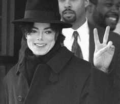 MJ flashing the peace sign