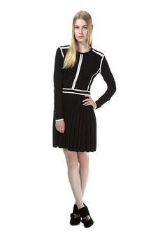 Knit sweater dress with boxy cream colored piping and pleated skirt. Exposed zip closure at rear.