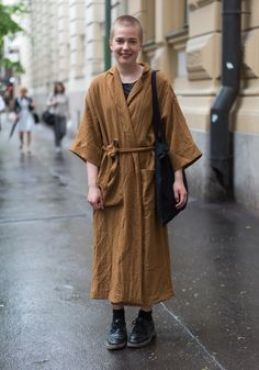 """""""I'm weairng a coat from Weekday, second hand pants and Dr Martens shoes. I like to wear clothes which have room to move in. I appreciate comfortable clothes made of natural materials. I'm especially inspired by old coats; the bigger and the more extraordinary the better."""""""