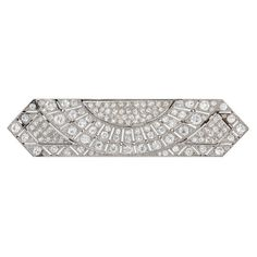 Art Deco Rectangular Sunburst Diamond Platinum Brooch   From a unique collection of vintage brooches at https://www.1stdibs.com/jewelry/brooches/brooches/