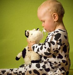 Baby with toy cow