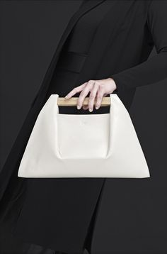Fashion designer Agnes Kovacs has created PONS, a simplistic and architectural handbag, that was inspired by the design of bridges.