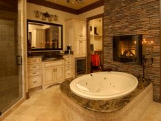 Fireplace next to a giant tub :)