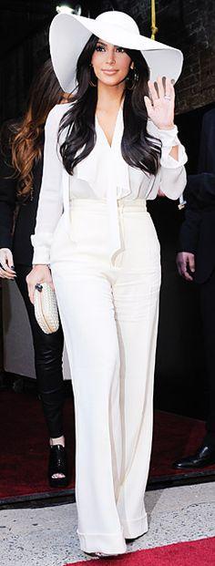 Kim Kardashian Channels Cher with Retro Look