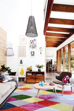Colorful interiors. Mixed with wood elements and interesting light fixtures. Cool bohemian vibe.