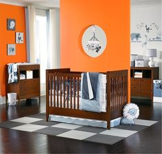 Orange Baby Room Decor. I don't even like orange but this is cute