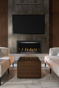 The Heat & Glo Cosmo linear fireplace with graphite trim brings character to this modern living room with wood paneled walls. Passive heat venting allows you to put a TV directly above the fireplace. Indoor Gas Fireplace, Linear Fireplace, Wood Fireplace, Fireplace Inserts, Modern Fireplace, Contemporary Fireplaces, Wood Panel Walls, Wood Paneling, Paneled Walls