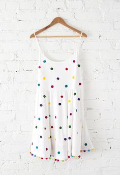 Save this simple style DIY project to turn your basic white dress into a pool party-ready polka dot pom pom one that's perfect for the summer.