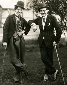 Charlie Chaplin in costume (sans make-up/mustache) & his idol Max Linder, who started in French cinema, 1905, becoming quite famous.